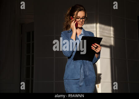 business woman in a business suit Office documents negotiations training - Stock Photo