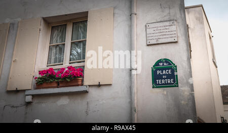 Paris, France - October 6, 2018: Place du Tertre panel and a commemorative marble plaque reminding that on December 24, 1898 an oil car driven by Loui - Stock Photo
