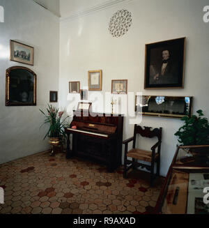 CHOPIN, Frederic (1810-1849). Polish composer. The  Carthusian hosted Chopin and G. Sand in the winter of 1838-1839. Cell 2 with the original scores by composer, literary manuscripts of Sand and goods from both relating their stay in La Cartuja. In the background, the piano of Chopin. Valldemosa. Mallorca. Balearic Islands. Spain. - Stock Photo