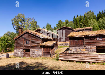 Old traditional Norwegian sod or turf roof log houses at Maihaugen Folks museum Lillehammer Oppland Norway Scandinavia - Stock Photo