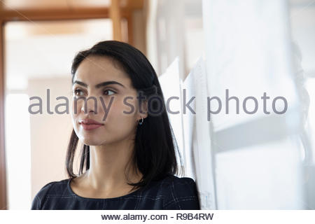 Thoughtful businesswoman looking away - Stock Photo