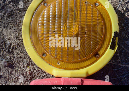 Cracked yellow warning lamp detail - Stock Photo