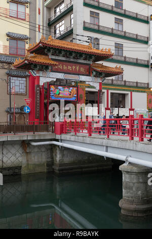 Nagasaki, Japan - October 22, 2018: Entrance over the bridge to Nagasaki Shinchi Chinatown, the oldest chinatown in Japan