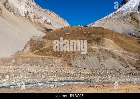 An ancient trading route crossing a pass between Nepal and Tibet in the Manaslu region of the Nepal Himalayas - Stock Photo