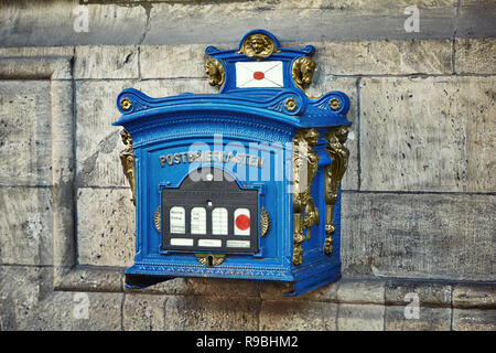 ERFURT, GERMANY - OCTOBER 4, 2010:  Old blue and bronze vintage post box on the building of Old Town Hall in Erfurt, Thuringia, Germany - Stock Photo