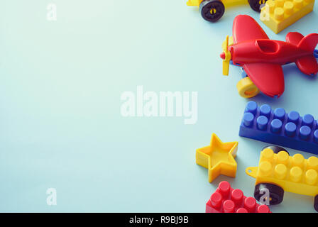 Side border of colorful kids toys on white with copy space