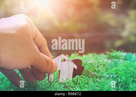 Key in hand and house model,is planning savings money of coins to buy a home concept concept for property ladder, mortgage and real estate investment. - Stock Photo