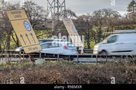 A car and van enter an average speed check area on the motorway due to narrow lanes and smart motorway upgrade - Stock Photo