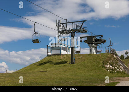 Chairlifts at Alta Badia ski area in the summer, Dolomites, Italy - Stock Photo