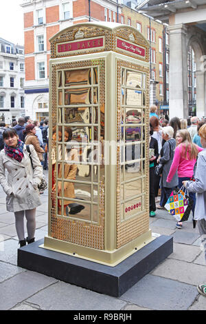 LONDON, UNITED KINGDOM - JUNE 23: Telephone booth in London on JUNE 23, 2012. Ted Baker Phone Box to celebrate ChildLine 25th anniversary at Covent Ga - Stock Photo