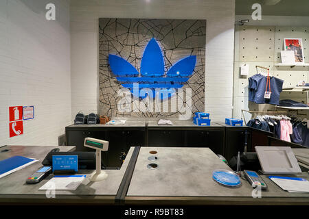 SAINT PETERSBURG, RUSSIA - CIRCA AUGUST, 2017: inside Adidas store at Galeria shopping center. Adidas AG is a German multinational corporation, that d - Stock Photo
