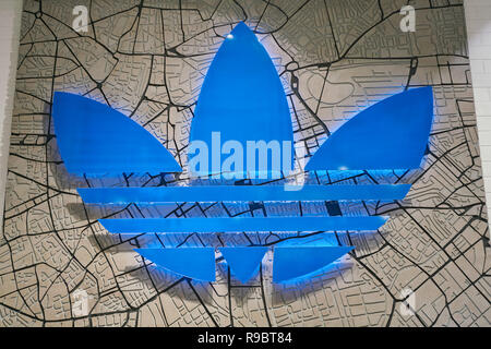 SAINT PETERSBURG, RUSSIA - CIRCA AUGUST, 2017: close up shot of Adidas sign. Adidas AG is a German multinational corporation, that designs and manufac - Stock Photo