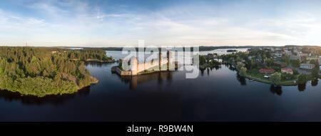 Olavinlinna castle in Savonlinna, Finland. Wide angle aerial panorama . - Stock Photo