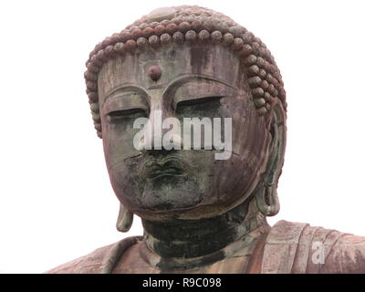 Close-up of the face of the giant bronze statue, almost 44ft tall, of the Great Buddha at Kotoku-in Temple, Kamakura; a designated National Treasure - Stock Photo