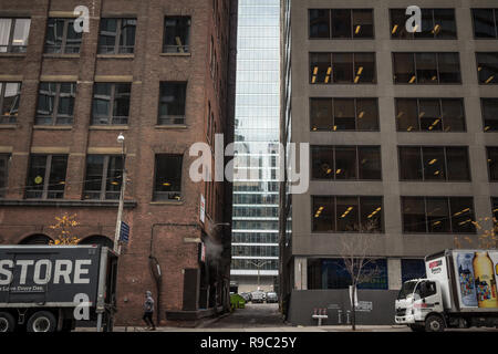 TORONTO, CANADA - NOVEMBER 13, 2018: Dead end street at the bottom of skyscrapers in downtown Toronto, ontario, Canada, in the CBD. with delivery truc - Stock Photo