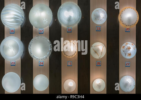 set of lamps on the stand in the light shop. - Stock Photo