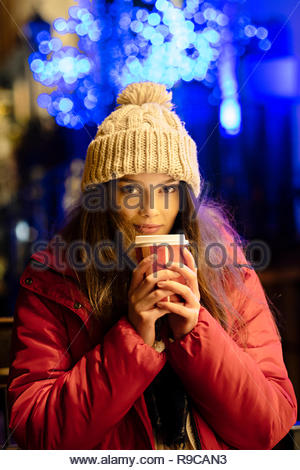 74e1b1820a0f Child drinking hot chocolate at Christmas tree at home. Kid opening ...