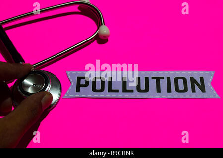 Pollution on the paper with healthcare concept. With stethoscope on pink bakcground - Stock Photo