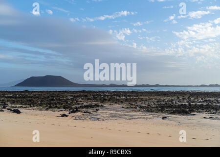 Lobos island, morning view seen from Corralejo Beach on Fuerteventura, Canary Islands, Spain - Stock Photo