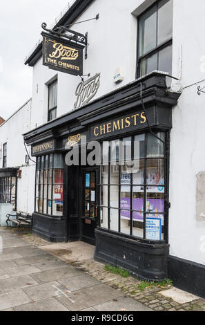 Old fashioned look Boots Dispensing Chemist shop front in Midhurst, West Sussex, England, UK. Boot Chemists. - Stock Photo