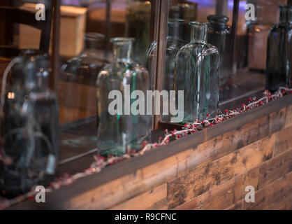 Antique Glass bottles on shelf as ornaments - Stock Photo