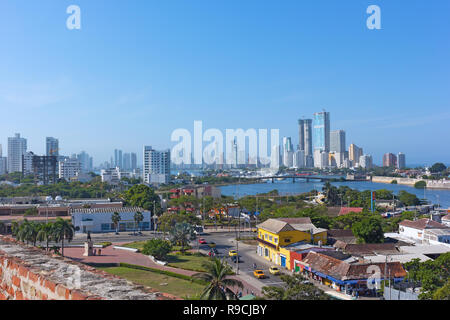 A view on historic and modern Cartagena de Indies of Colombia from San Filipe de Barajas Castle. City panorama and waters of Caribbean Sea. - Stock Photo