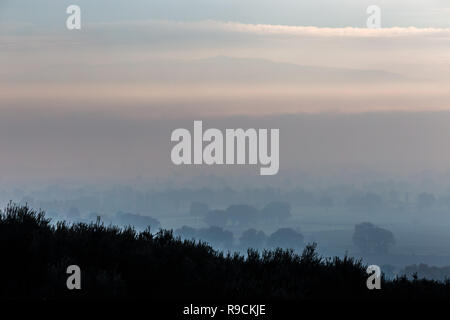 Moody view of Umbria valley (Italy) in the midst of autumn mist
