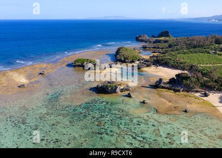 Aerial drone view of beautiful tropical beaches, small islands and surrounding coral reef, Beach 51. Zanee Hama, Cape Maeda, Okinawa, Japan - Stock Photo