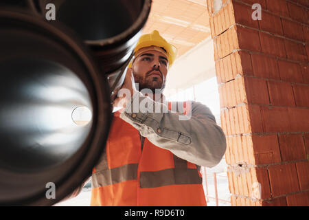 Portrait Of Young Man Working In Construction Site