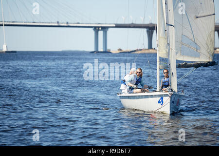 Three friends in sail boat - Stock Photo