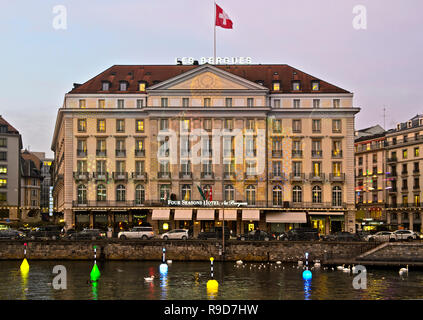 Geneva Lux Festival, creation Les Flotteuses by Stephane Durand in fornt of the illuminated Four Seasons Hotel des Bergues, Geneva, Switzerland - Stock Photo