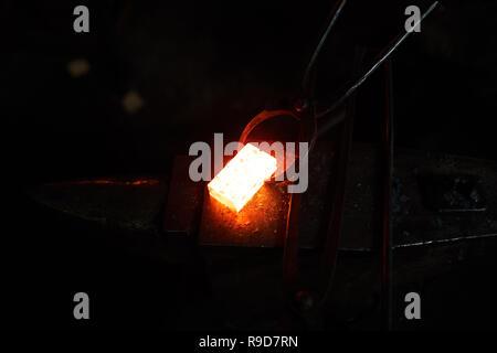 Work on anvil - Stock Photo