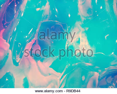 Holographic multicolored real crumpled texture background in blue and pink shades. - Stock Photo