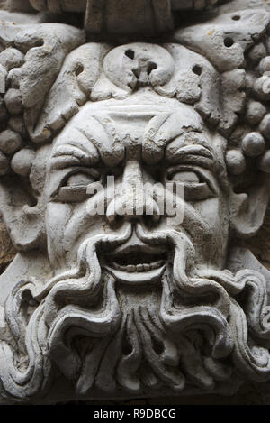 Carved portrait of Bacchus, Roman god of wine and festivities, or Dionysus among the Greeks - Stock Photo