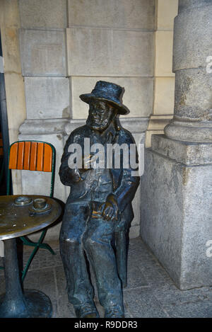 Statue of Piotre Cezary Skrzynecki.This statue is situated in front of a cafe at the Main Market Square. He was a Polish choreographer and director - Stock Photo