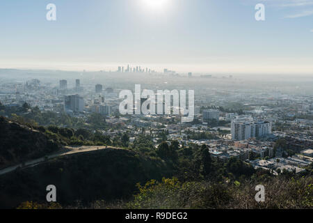 Los Angeles, California, USA - December 16, 2018:  Cityscape view of Runyon Canyon Park hiking trails, Hollywood and downtown LA. - Stock Photo