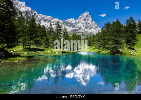 Amazing view of the Matterhorn (Cervino) reflected on the Blue Lake (Lago Blu) near Breuil-Cervinia, Aosta Valley, Italy - Stock Photo