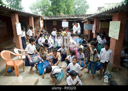 Varanasi / India 20 September 2011  Rural Indian village school children gathering outside the class room at Varanasi Uttar Pradesh India - Stock Photo