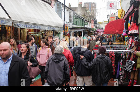 Brighton, UK. 23 December 2018. Christmas shoppers out in force in the bohemian North Laine district of Brighton as thousands flock to the shops this weekend Credit: Simon Dack/Alamy Live News - Stock Photo
