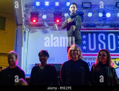 Manama, Bahrain. 21st Dec, 2018. Actor Milo Ventimiglia takes part in the Joint Chiefs USO Christmas Show for deployed service members at Naval Support Activity Bahrain December 22, 2018 in Manama, Bahrain. This year's entertainers include actors Milo Ventimiglia, Wilmer Valderrama, DJ J Dayz, Fittest Man on Earth Matt Fraser, 3-time Olympic Gold Medalist Shaun White, Country Music Singer Kellie Pickler, and comedian Jessiemae Peluso. Credit: Planetpix/Alamy Live News - Stock Photo