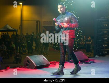 Manama, Bahrain. 21st Dec, 2018. Actor Wilmer Valderrama takes part in the Joint Chiefs USO Christmas Show for deployed service members at Naval Support Activity Bahrain December 22, 2018 in Manama, Bahrain. This year's entertainers include actors Milo Ventimiglia, Wilmer Valderrama, DJ J Dayz, Fittest Man on Earth Matt Fraser, 3-time Olympic Gold Medalist Shaun White, Country Music Singer Kellie Pickler, and comedian Jessiemae Peluso. Credit: Planetpix/Alamy Live News - Stock Photo