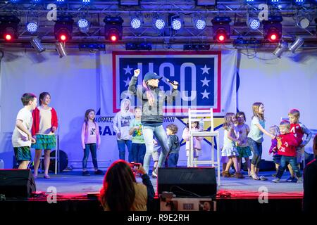 Manama, Bahrain. 21st Dec, 2018. Comedian Jessiemae Peluso takes part in the Joint Chiefs USO Christmas Show for deployed service members at Naval Support Activity Bahrain December 22, 2018 in Manama, Bahrain. This year's entertainers include actors Milo Ventimiglia, Wilmer Valderrama, DJ J Dayz, Fittest Man on Earth Matt Fraser, 3-time Olympic Gold Medalist Shaun White, Country Music Singer Kellie Pickler, and comedian Jessiemae Peluso. Credit: Planetpix/Alamy Live News - Stock Photo