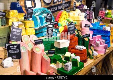 Colourful display of natural handmade soaps at Lush Oxford Street store, London, UK - Stock Photo