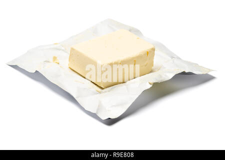 Piece of organic butter on a white background - Stock Photo