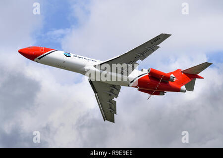 Boeing 727-2S2F (RE) Oil Spill Response aircraft reveals the high-lift devices in its wings as well as the spray boom mounted beneath the engines. - Stock Photo