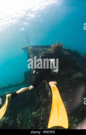 Diver without scuba explores the wrecked ship - Stock Photo