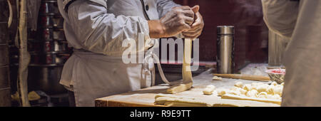Chinese chef making dumplings in the kitchen BANNER, LONG FORMAT - Stock Photo