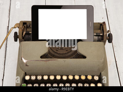 Concept of technology progress - old typewriter and new tablet pc on wooden background. Copy space - Stock Photo