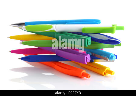 Multi colored ball pens on white background - Stock Photo