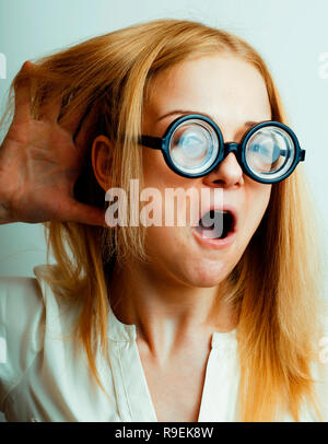 bookworm, cute young  woman in glasses, blond hair, teenage goof - Stock Photo
